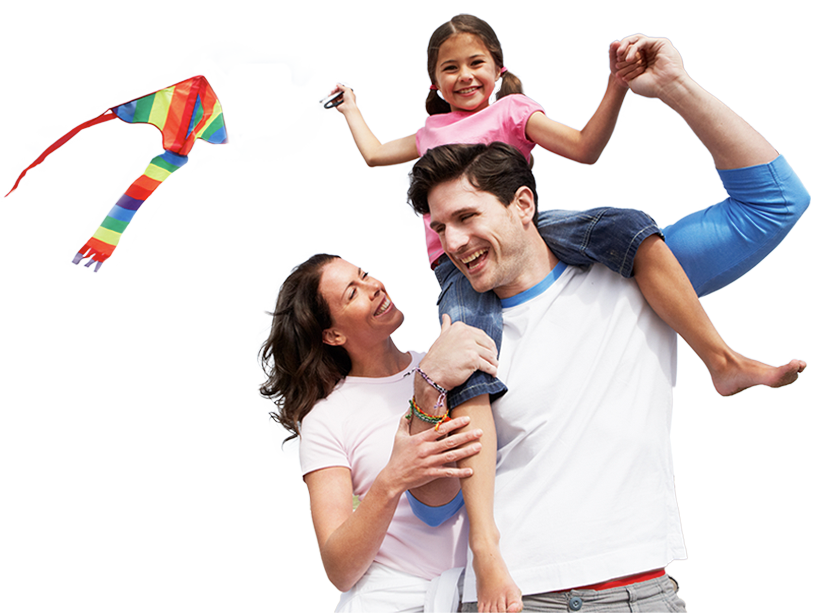 family smiling and flying a kite