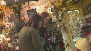 women shopping in a store filled with antiques
