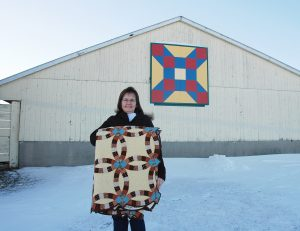 Sharlyn Larson and her Farmer's Daughter Barn Quilt - Southern Trail