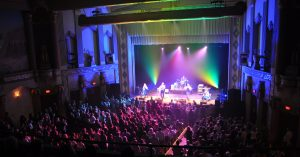 interior shot of a band performing at the Egyptian Theatre