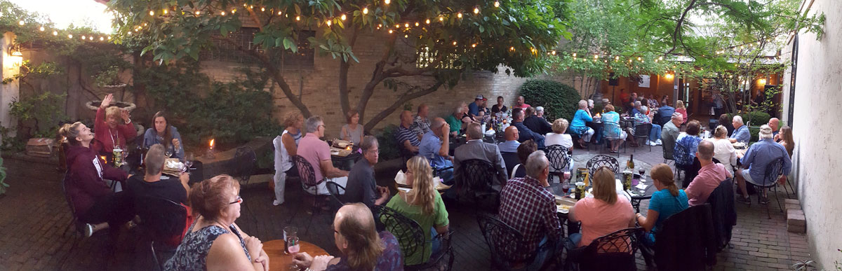 group of people sitting on the prairie state winery patio