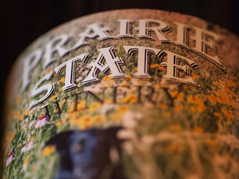close up of prairie state winery logo on wine bottle