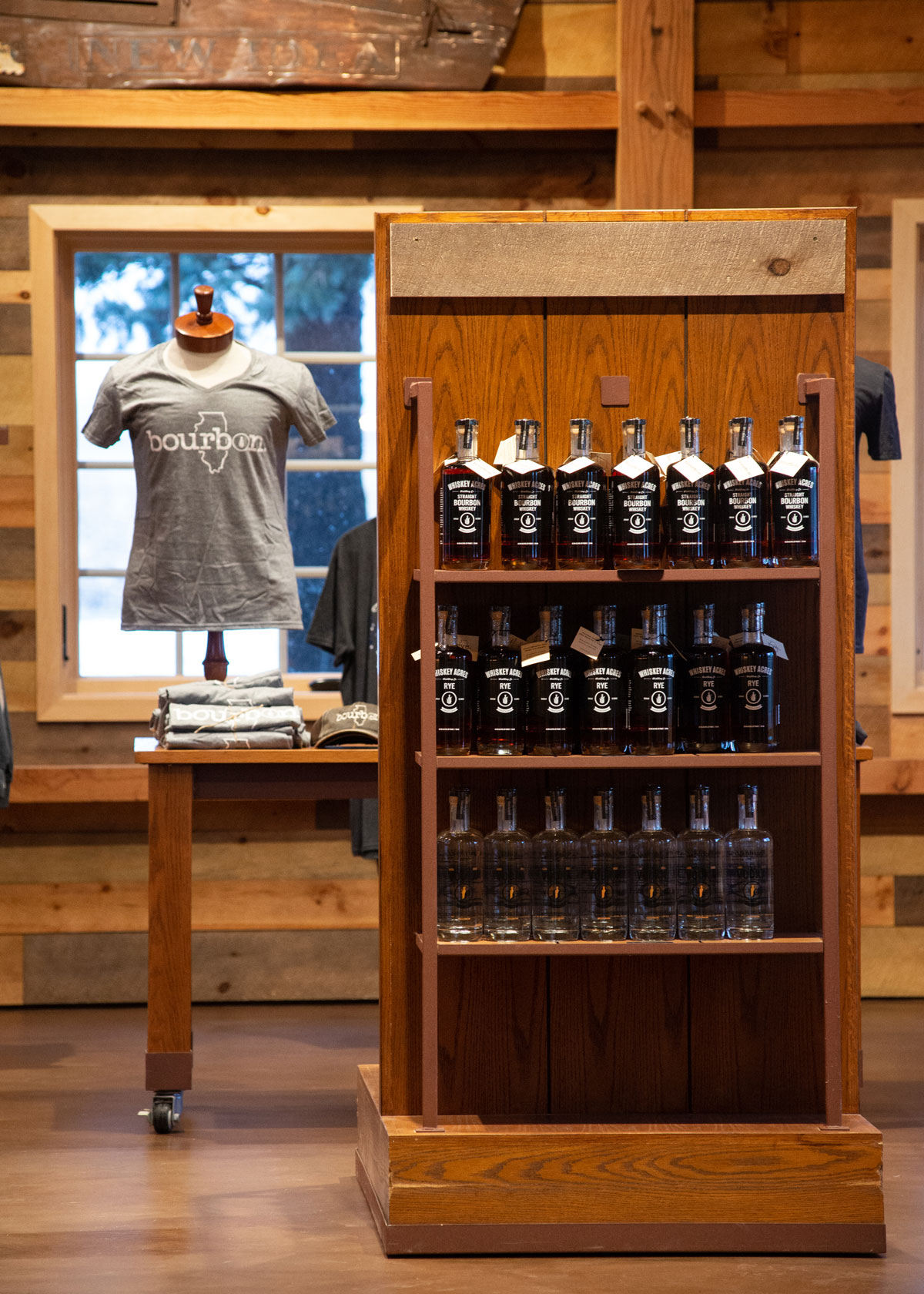 whiskey acres gift options, a t-shirt and whiskey